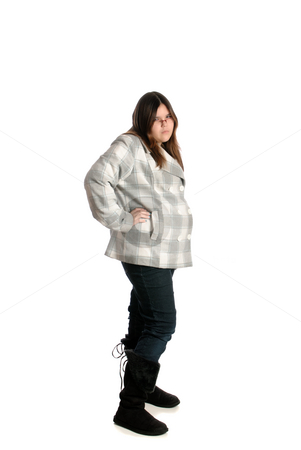 Teenage Attitude stock photo, A full body view of a teenage girl looking mad and showing attitude, isolated against a white background. by Richard Nelson