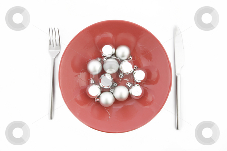 Red plate with Christmas silver ball stock photo, Red plate with Christmas silver ball on white background by caimacanul