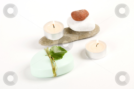 Green soap, candle and colored stones stock photo, Green soap, candle and colored stones, spa concept by caimacanul