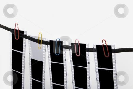Film strip stock photo, Five film strip and colored paper clip by caimacanul