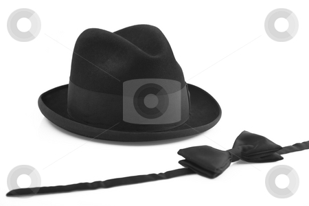 Black vintage hat and bow-tie on white background stock photo, Black vintage hat and bowtie on white background by caimacanul