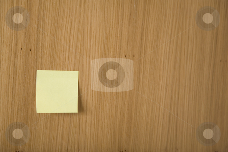 Post it stock photo, Yellow post it on wooden board by caimacanul