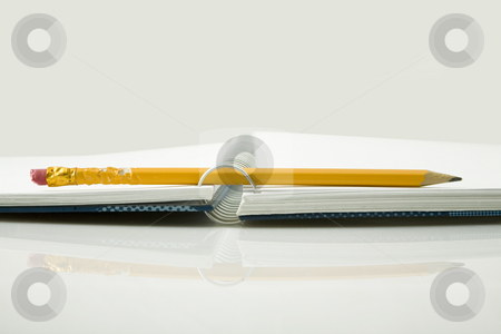 Chewed pencil stock photo, Chewed yellow pencil and notebook by caimacanul