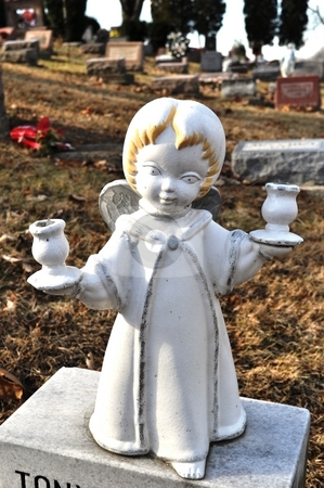 Gravesite - Angel - blonde with candle holders stock photo, Gravesite - Angel - blonde with candle holders by Liane Harrold