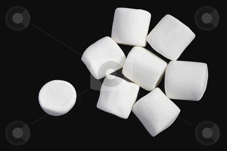 Marshmallows stock photo, Group of white marshmallows on black background by Olena Pupirina
