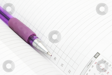 Ruled diary and a pen stock photo, A lined diary with calendar and a pen by Olena Pupirina