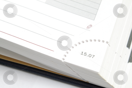 A corner of diary stock photo, A corner of a diary page with date on it by Olena Pupirina