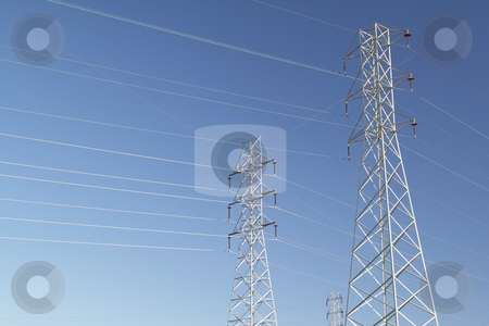 High voltage power lines stock photo, High voltage power lines over blue sky by Olena Pupirina