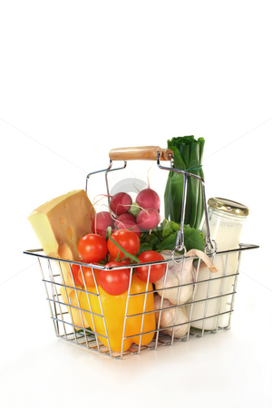 Shopping basket stock photo, Shopping basket with milk, cheese and mixed vegetables by Maren Wischnewski