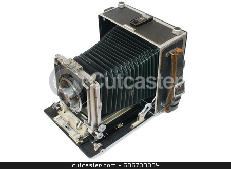 Old bellows press camera. stock photo, Old style large format 5x4 press and studio camera with extended bellows by Stephen Rees
