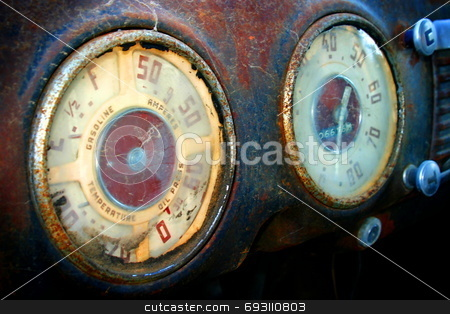 Old Speedometer stock photo, An old Chevrolet that I found at the side of a road. I like the texture of the rust in the photo. by Henrik Lehnerer