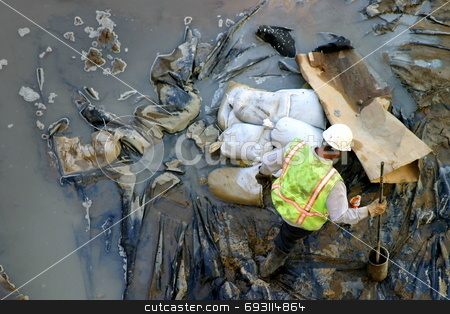 Construction worker in the Mud stock photo, Worker at a construction site by Henrik Lehnerer