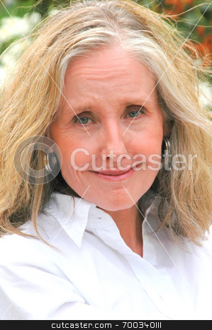 Mature woman stock photo, Portrait of a mature businesswoman  relaxing. by OSCAR Williams