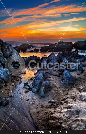 Sunset on the beach stock photo,  by Luis Luc?