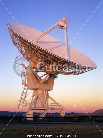 Satellite dish and full moon stock photo, A satellite dish, part of the VLA (Very Large Array) Radio Telescope in New Mexico. by Mike Norton