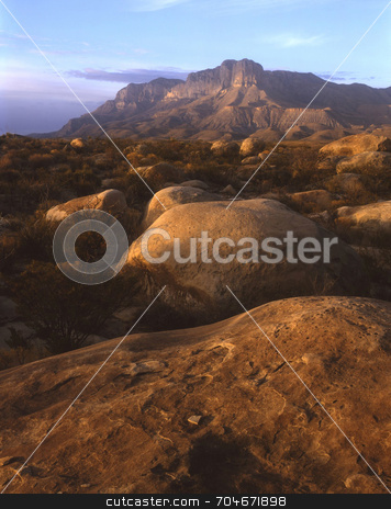 Guadalupe Mountains and Boulders stock photo, Boulders and the Guadalupe Mountains in west Texas. by Mike Norton