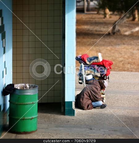 Homeless man stock photo, Life is hard in California! A homeless person sitting in Ventura, CA near the beach, waiting for  by Henrik Lehnerer