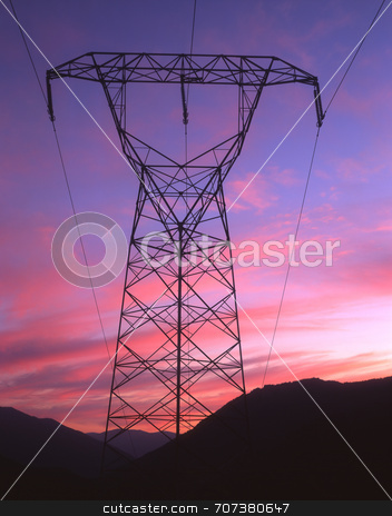 High Tension stock photo, Electric power lines and tower photographed at sunset. by Mike Norton