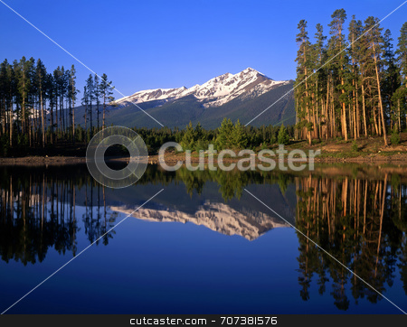 Lake Dillon stock photo, Mountain peaks and trees reflecting in Lake Dillon located in the Arapaho National Forest of Colorado. by Mike Norton