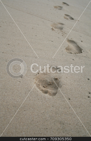 Footsteps On The Beach stock photo, A persons footsteps on the beach, coming towards you, with a selective focus. by Daniel Wiedemann