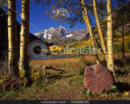 Maroon Bells stock photo, The Maroon Bells & Maroon Lake in the White River National Forest of Colorado, photographed during the autumn season. by Mike Norton