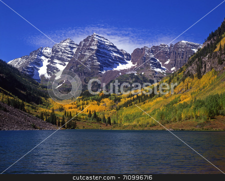 Maroon Bells and Maroon Lake stock photo, The twin peaks of the Maroon Bells and Maroon Lake in the White River National Forest of Colorado. by Mike Norton