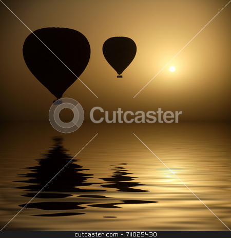 Hot Air Balloons At Eye Level stock photo, Two hot air balloon silhouettes  in the dry morning of Luxor, Egypt.  (with water reflection) by Daniel Wiedemann
