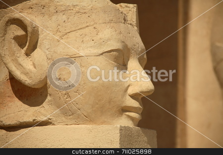 Egyptian Statue stock photo, A large stone egyptian statue outside the Hatshepsut Temple in Luxor. by Daniel Wiedemann