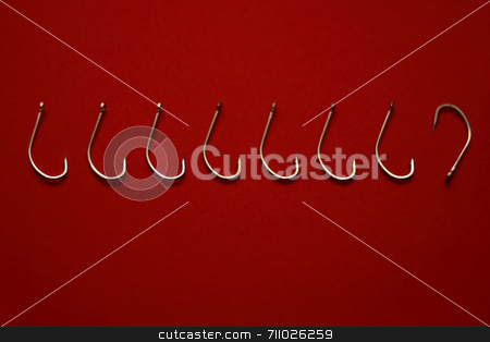 Fishing Hook Odd one out stock photo, A set of fishing hooks set in a straight line with one fishing hook facing the wrong way by Daniel Wiedemann