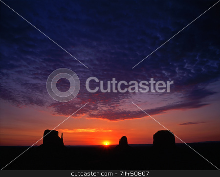 Monument Valley stock photo, Sunrise and the Mitten Buttes in Monument Valley Navajo Tribal Park, Arizona. by Mike Norton