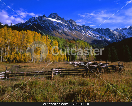 Mt. Sneffels and Corral stock photo, A corral and Mt, Sneffels in the Uncompahgre National Forest of Colorado, photographed during the autumn season. by Mike Norton