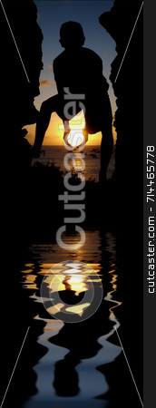 Holding the Sun stock photo, The silhouette of a young person holding the Sun.   (with water reflection) by Daniel Wiedemann