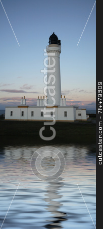 Lighthouse stock photo, A white lighthouse at dusk and a blue sky.  (with water reflection) by Daniel Wiedemann