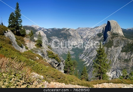 Yosemite Half Dome stock photo, The Yosemite National Park is one of the big attraction and tourist destinations in California. It is magnificent with its mountains and waterfalls. by Henrik Lehnerer