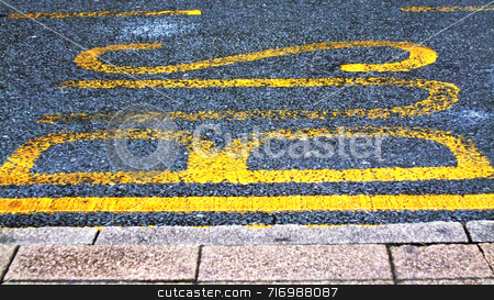 Bus Lane stock photo, BUS painted onto road tarmac to signal a bus stop by Philippa Willitts