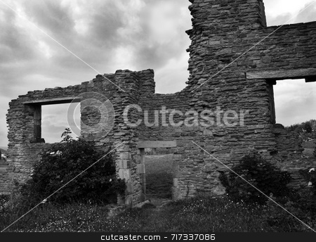 Ruins Under a Moody Sky stock photo, A ruined lodge under a moody, stormy sky by Philippa Willitts