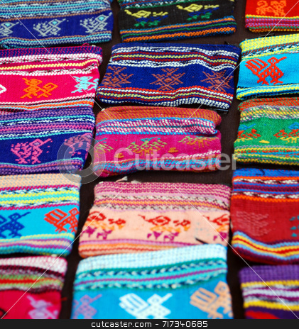 Woven Wallets stock photo, A display of woven purses at an outdoor market by Philippa Willitts