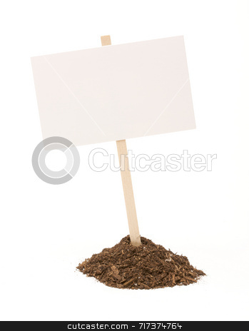 Blank White Sign in Dirt Pile Isolated stock photo, Blank white sign in mount of dirt isolated on a white background. by Andy Dean