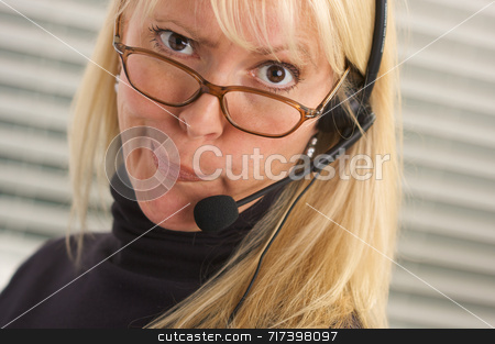 Attractive Businesswoman with Phone Headset stock photo, Goofy businesswoman talks on her phone headset. by Andy Dean