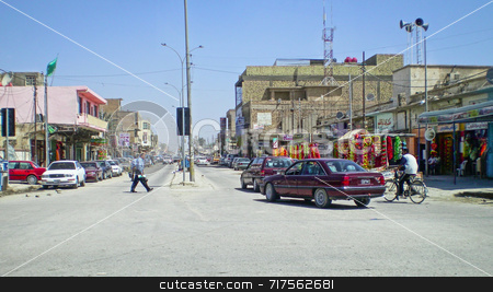 Iraq Street stock photo, Iraqi street people and cars with buildings either side by Stefan Edwards