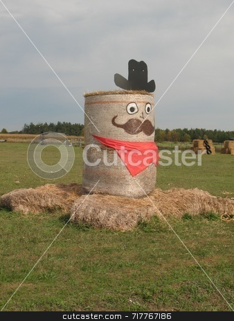 Western Days stock photo, Halowe'en figure made of rolls of hay at farm. by Ray Carpenter