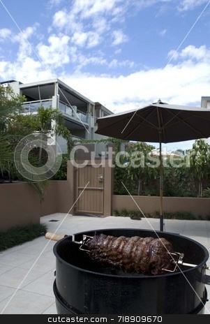 Barbeque stock photo, A big beef roast on a barbeque in the backyard by Maria Bell