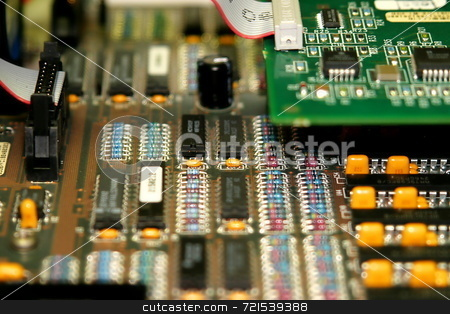 Motherboard stock photo, Motherboard with different types of chips and colors by Henrik Lehnerer