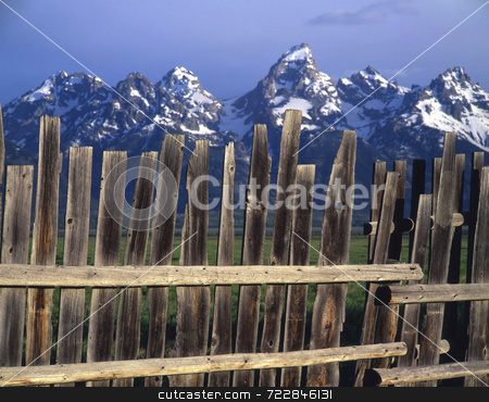 Teton Fence stock photo, A fence that mimics the Grand Teton Mountains in the background. by Mike Norton