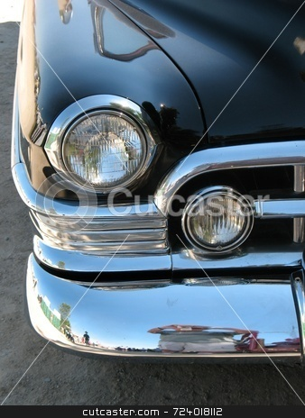 Vintage Automobile stock photo, Image of the front right fender showing the headlights of a 1950 Cadillac. by Ray Carpenter