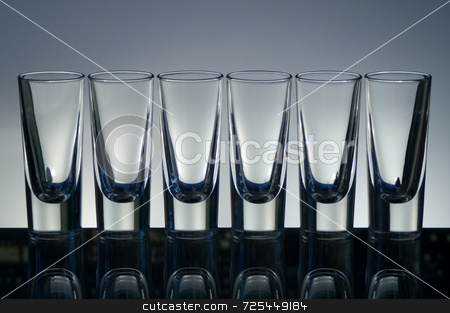 Empty vodka glasses stock photo, KONICA MINOLTA DIGITAL CAMERA by Thomas Gavagan