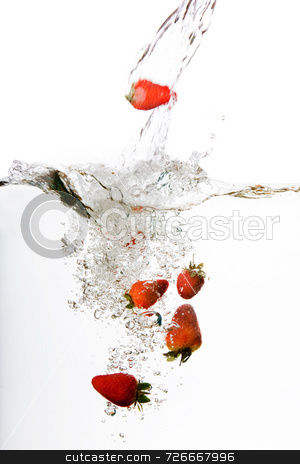 Water Strawberry stock photo, Strawberries in water floating and bubbling by Tyler Olson