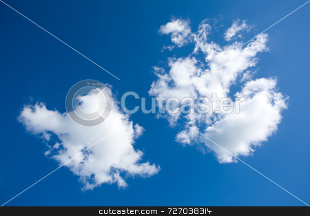 Fluffy clouds stock photo, Fluffy clouds in a deep blue sky by Jon Stokes