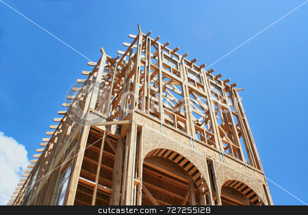 Framed Construction House stock photo, This is a new home under construction and still in the framing stage by Kevin Tietz