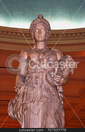 Single Classical Woman Statue stock photo, A single classical statue of a women holding a basket by Kevin Tietz